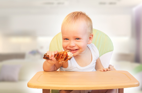 Small child eating meat